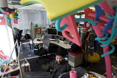 Vitaliy Lvin, a software engineer, works at Google's Cambridge office, surrounded by foam toys.